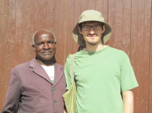 "Patrick, our diwani (which is roughly the equivalent of a city councilman, I believe), poses with Andrew.  Just like my villager name is Mwinga, Andrew's is/was Mwile, which means ""Chief"" (he picked it himself)."