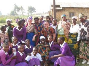 Meesh poses with some of the village mamas and students.