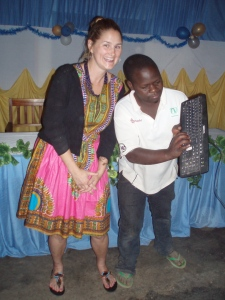Everyone wants a picture with the mzungu!  Here I am posing for a photo with the DJ and his keyboard.  I love this picture more than I can possibly express.